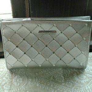 Michael KORS' silver metallic cosmetic bag